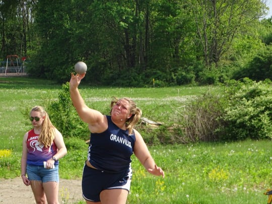 Granville senior Addison Hoover competes in the shot put Tuesday during the Licking County League-Buckeye Division championships at Lakewood. Hoover won the event.
