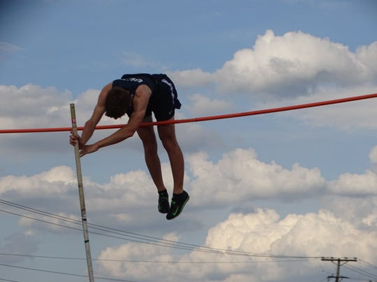 Granville senior Isaac Cramer competes in the pole vault May 7 during the Licking County League-Buckeye Division championships at Lakewood. Cramer finished second in the event.