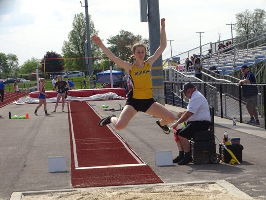 Watkins Memorial freshman Jenna Lucas competes in the long jump May 7 during the Licking County League-Buckeye Division championships at Lakewood. Lucas won the event.
