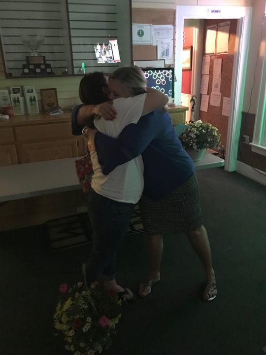 Lakewood bond issue committee chairman Jessica Corum and superintendent Mary Kay Andrews hug, after the issue again went down to defeat Tuesday.