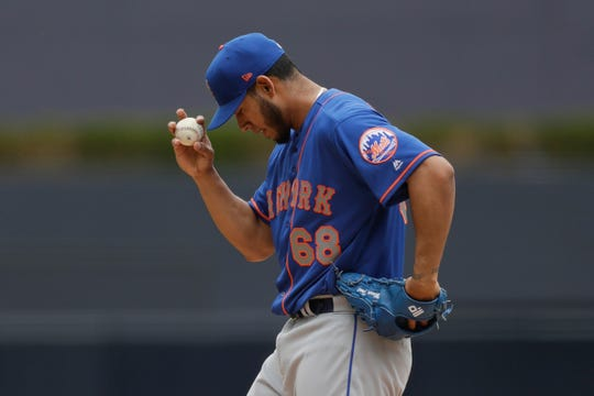 New York Mets starting pitcher Wilmer Font works against a San Diego Padres batter during the first inning of a baseball game Wednesday, May 8, 2019, in San Diego.