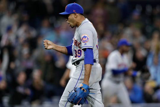 New York Mets relief pitcher Edwin Diaz celebrates after defeating the Mets defeated the San Diego Padres 7-6 in a baseball game Tuesday, May 7, 2019, in San Diego.