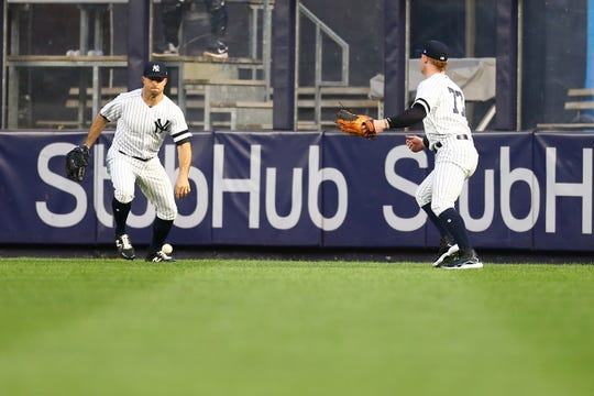 Brett Gardner, left, and Clint Frazier (77) of the New York Yankees watch the ball drop in between them off the bat from Jay Bruce of the Seattle Mariners in the second inning at Yankee Stadium on May 07, 2019.