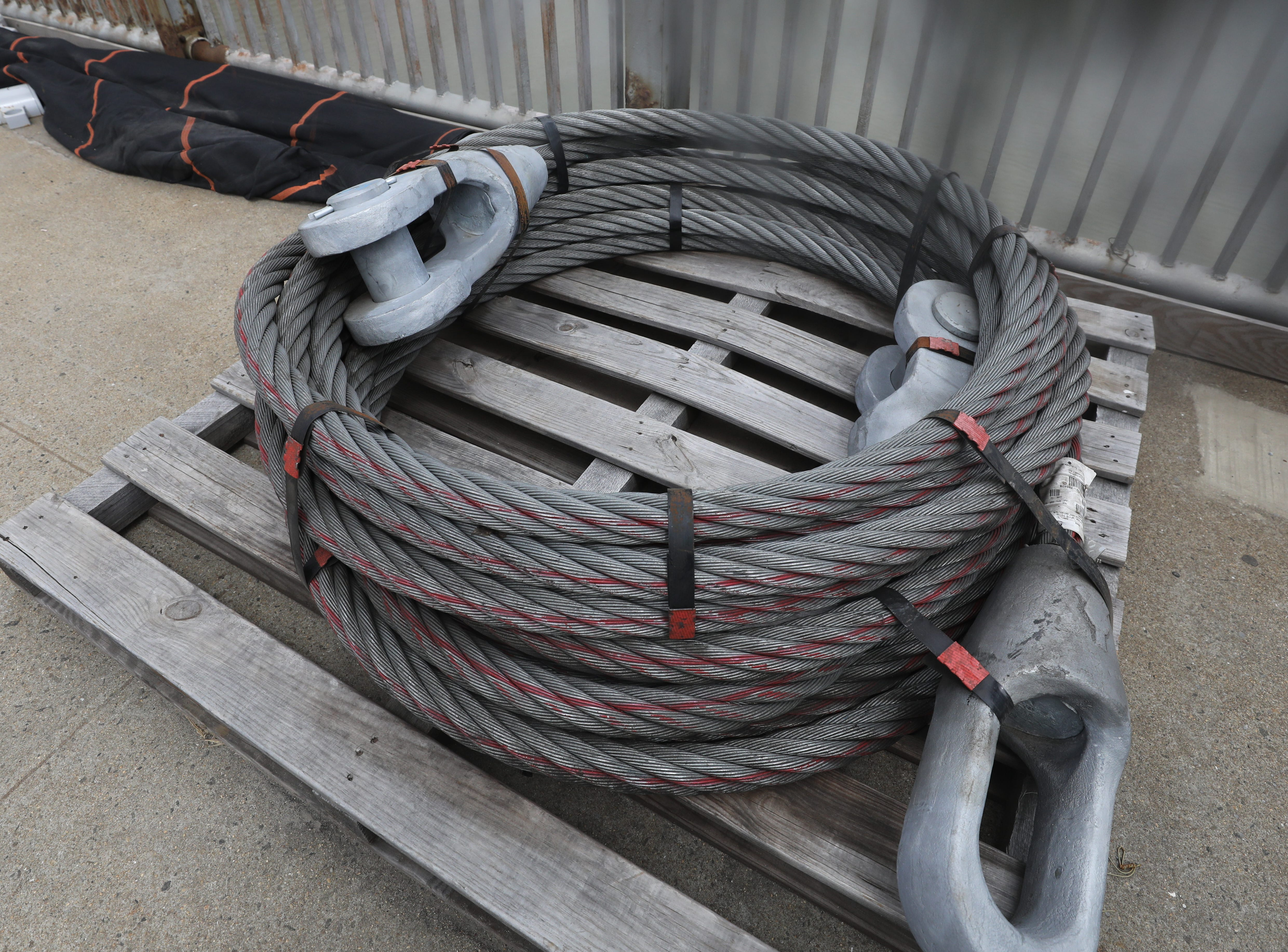 One of the suspender ropes that is to be used attached to the barrel cable to help hold up the roadway.