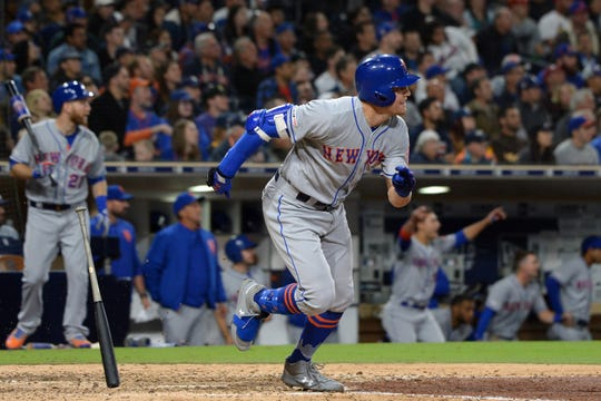 May 7, 2019; San Diego, CA, USA; New York Mets center fielder Brandon Nimmo (9) hits a game tying RBI double in the seventh inning against the San Diego Padres at Petco Park.