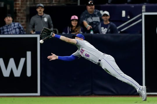 New York Mets left fielder Jeff McNeil misses the ball on a double by San Diego Padres' Eric Hosmer during the sixth inning of a baseball game Tuesday, May 7, 2019, in San Diego. (AP Photo/Gregory Bull)