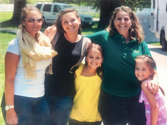 Anna Gassib pictured with her children Torre, Ronni, Mary, and Abby.