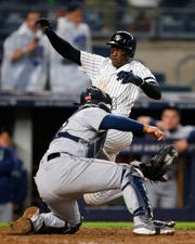 May 7, 2019; Bronx, NY, USA;  New York Yankees left fielder Cameron Maybin (38) beats the tag of Seattle Mariners catcher Omar Narvaez (22) in the ninth inning at Yankee Stadium.