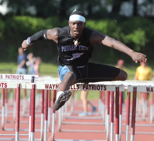Shamir Taylor of Passaic Tech on his way to winning the 110 meter hurdles at the Passaic County Championships on Wednesday, May 8, 2019. PCT also won the boys team title.