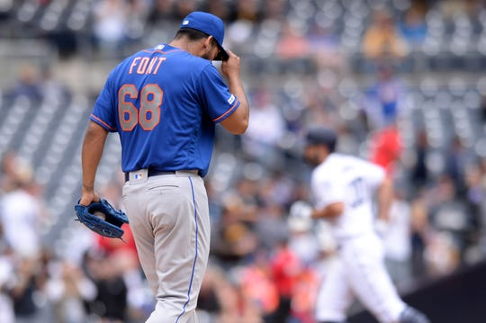 May 8, 2019; San Diego, CA, USA; New York Mets starting pitcher Wilmer Font (68) reacts on the mound after giving up a home run to San Diego Padres first baseman Eric Hosmer (right) during the second inning at Petco Park.