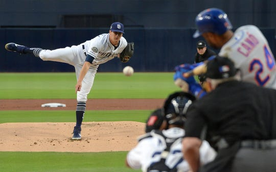 May 7, 2019; San Diego, CA, USA; San Diego Padres starting pitcher Cal Quantrill (40) pitches to New York Mets second baseman Robinson Cano (24) during the first inning at Petco Park. Cano got a hit in this at-bat for his 2,500th career hit.