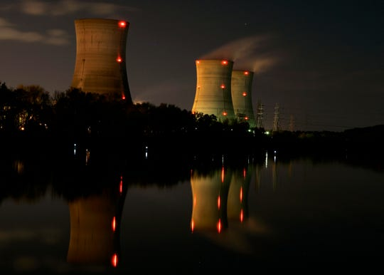 FILE - In this Nov. 2, 2006, file photo, cooling towers of the Three Mile Island nuclear power plant are reflected in the Susquehanna River in this image taken with a slow shutter speed in Middletown, Pa.