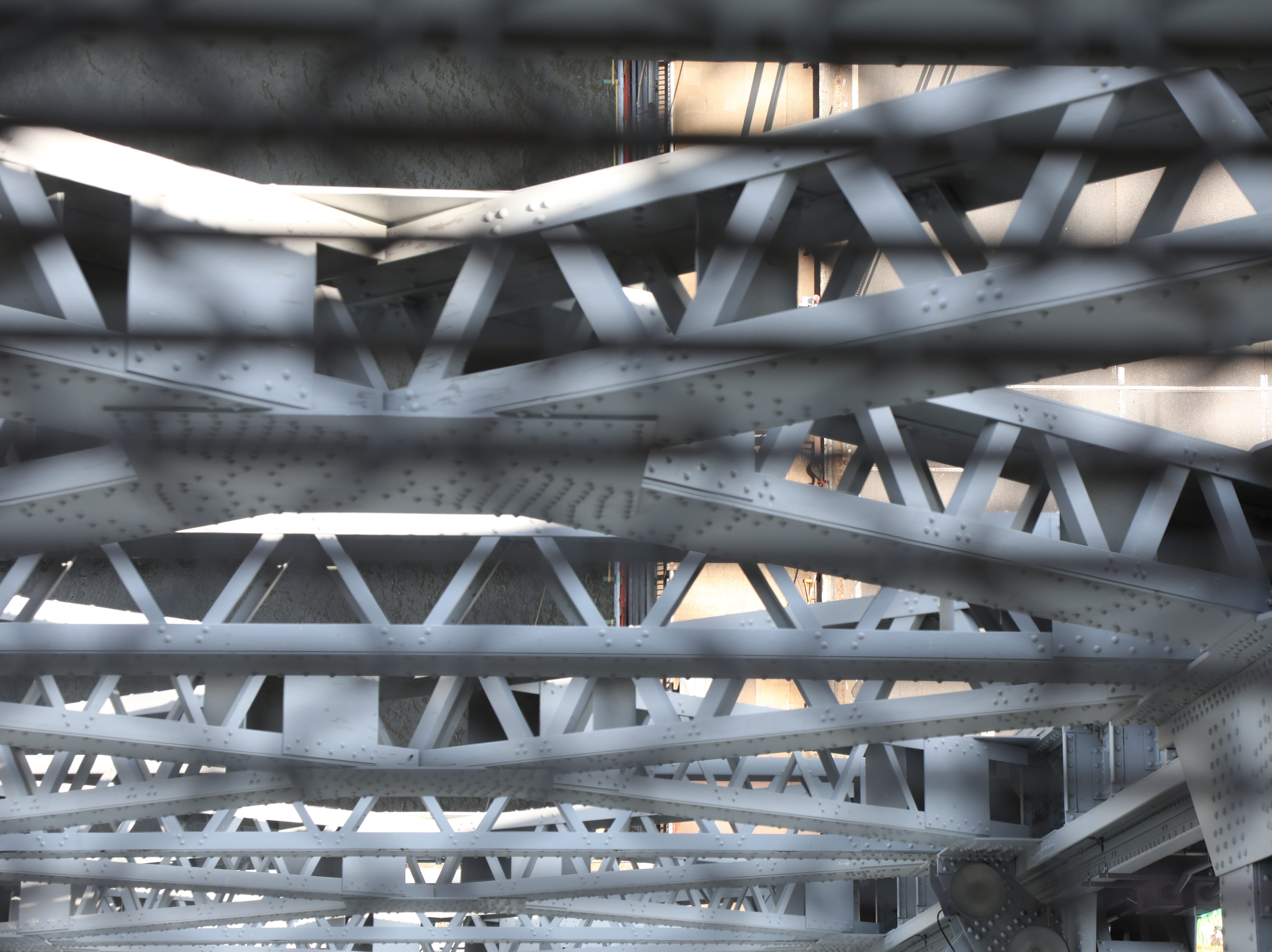 The looking down through the metal floor grates from the the west tower.