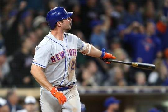 Pete Alonso #20 of the New York Mets watches his two-run home run during the ninth inning of a game against the San Diego Padres at PETCO Park on May 07, 2019 in San Diego, California.