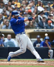 Tomas Nido of the New York Mets hits a single during the fifth inning of a baseball game  against the San Diego Padres at Petco Park May 8, 2019 in San Diego, California.