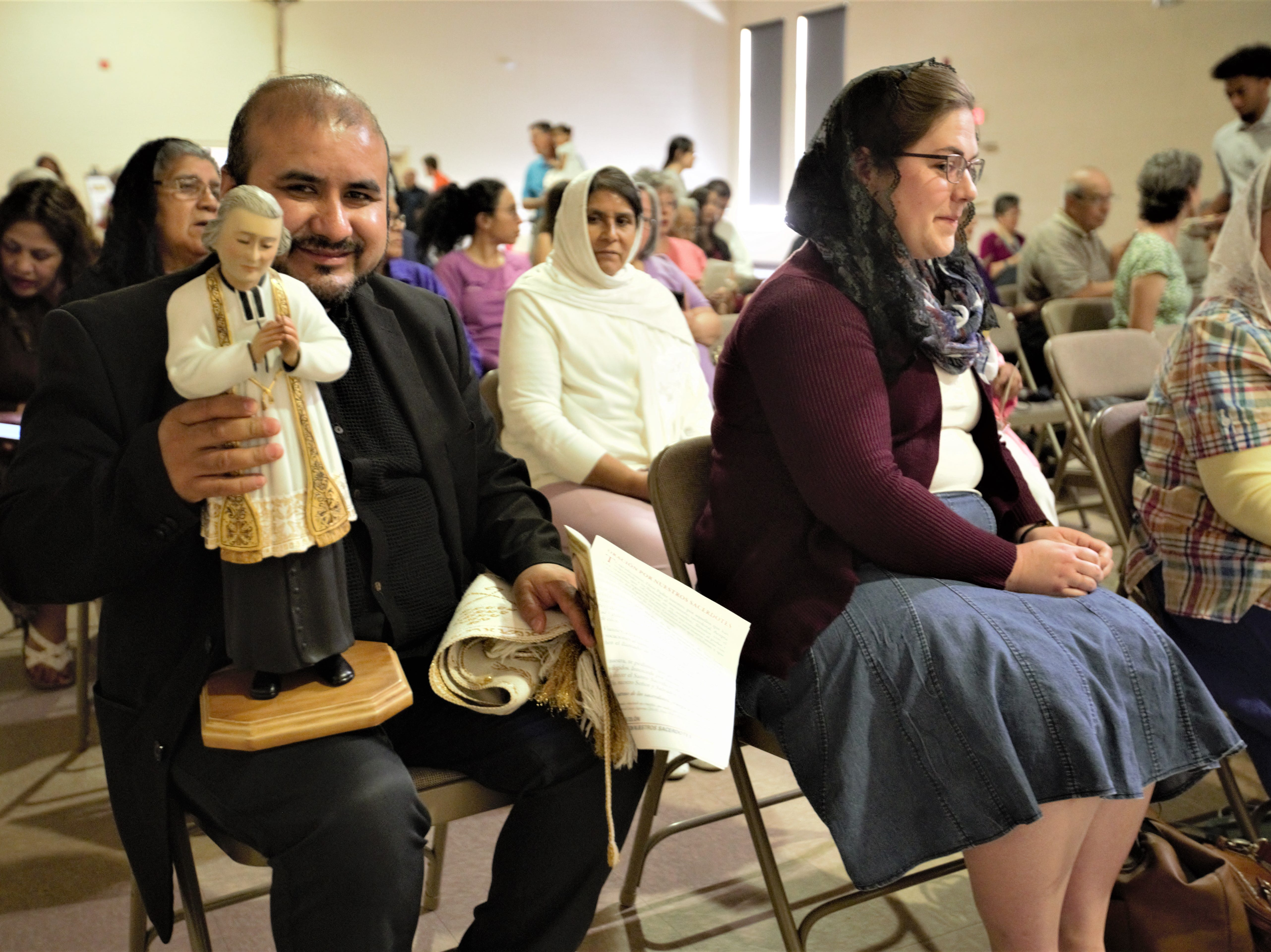 Rev. Alejandro Reyes of Our Lord of Mercy Catholic Church in Las Cruces holds a statue of St. Jean Vianney during a veneration of the saint at the Cathedral of the Immaculate Heart of Mary on Tuesday, May 7, 2019.