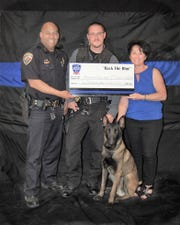 From left: APD Chief Brian Peete, Officer Christoph Wallenstein, K-9 Odin and Otero County Law Enforcement Appreciation Committee Chairwoman Rocky Gallasini. The LEA donated $6,000 to the APD K-9 program.