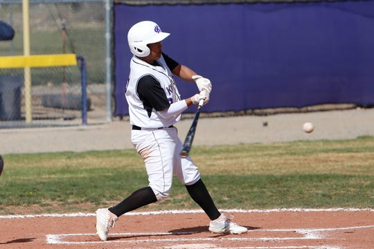 Kirtland Central's Ethan Yazzie hits a double against Shiprock during a District 1-4A game on Thursday, April 11 at KCHS. The No. 11 Broncos will play at No. 6 Santa Teresa in this weekend's 4A playoff opener.