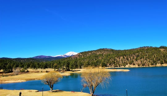 Sierra Blanca mountain view from Inn of the Mountain Gods lake. The surrounding area offers hiking trails golf, paddle boats and more. A place to relax and take in all the beauty of Ruidoso.