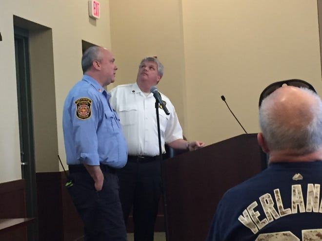 Plymouth Township Fire Chief Dan Phillips (right) and Captain Chris Mack discuss the plan for the township to take over all ambulance transport runs.
