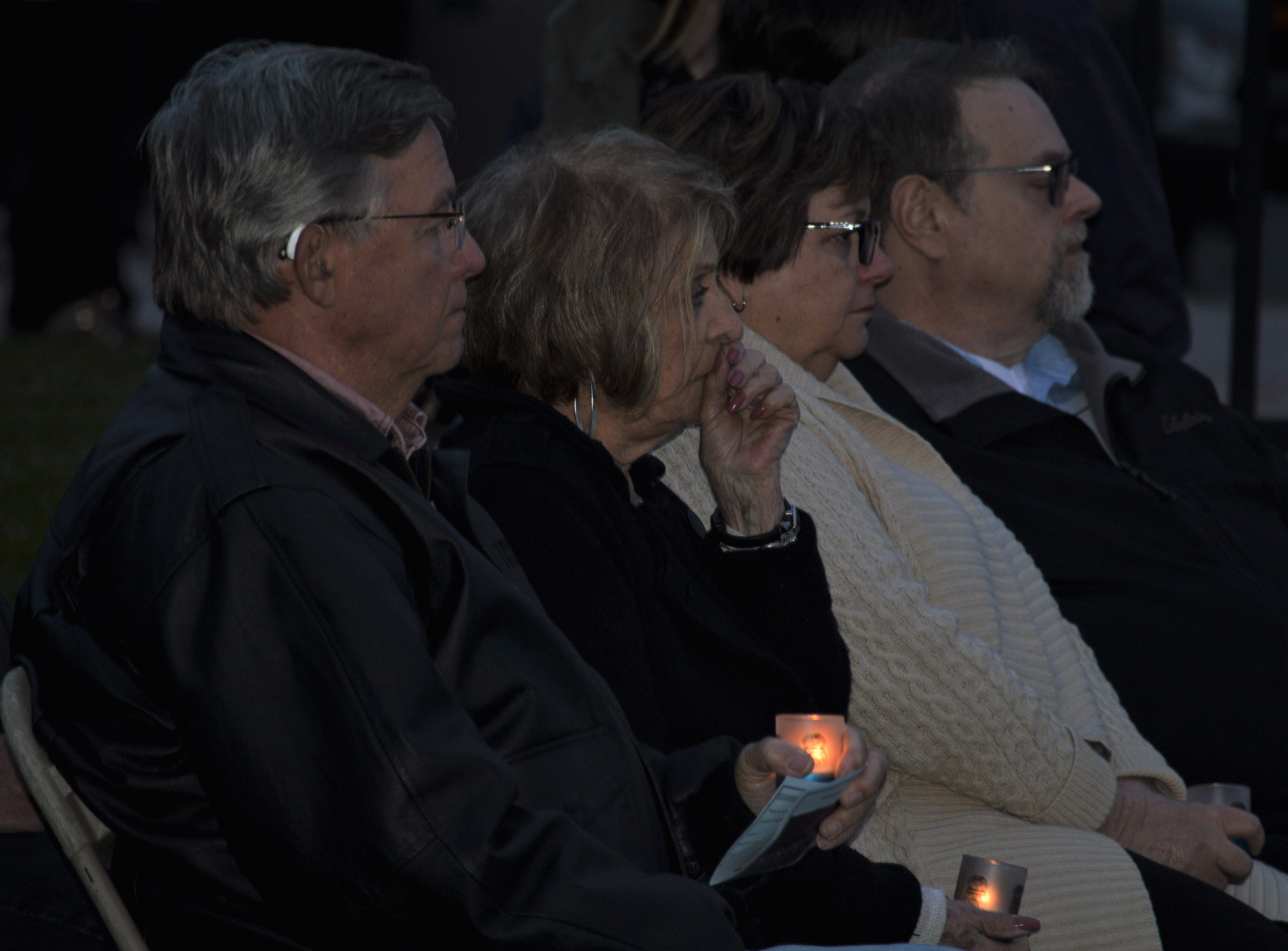 Those who attended the fifth annual Livonia Police Memorial Ceremony lit candles to honor their lost police officers.