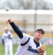 Stevenson Spartan Nate Waligora pitches some warm-up before the second inning of his team's May 8 home game.