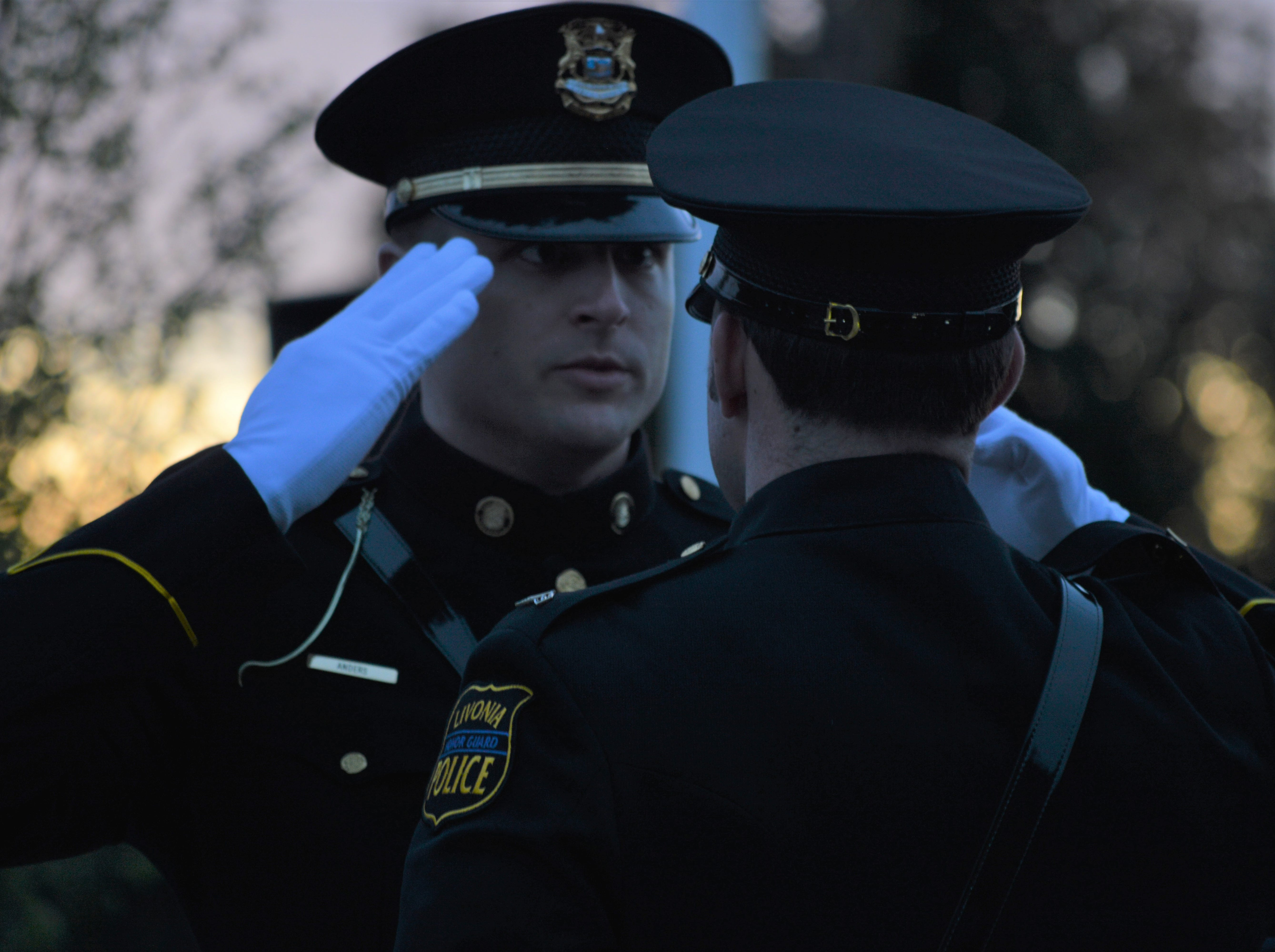 Police officers saluted each other during the fifth annual Livonia Police Memorial Ceremony on Tuesday, May 7, 2019.