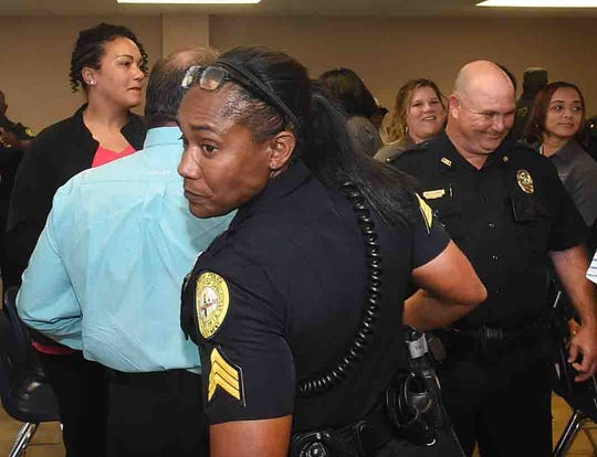 """Opelousas residents get to know officers with the Opelousas Police Department during a """"meet and greet"""" event recently held at Opelousas City Hall."""