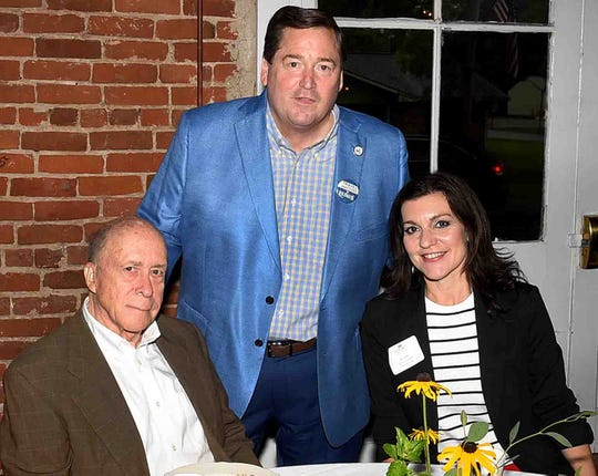 Lt. Gov. Billy Nungesser  visits with Bobby Ardoin and Melanie LeBouef at Wednesday's National Tourism Week Breakfast held at Wolff Hall in historic Washington, La.