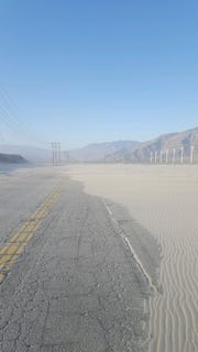 This photo shows Indian Canyon Drive at the Whitewater Wash on May 8. Blowing sand shut down the road and traffic is being diverted to other streets.