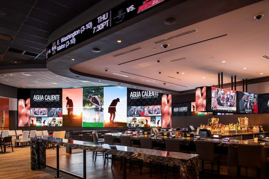 A sports tickers runs across the top of a bar at the 360 Sports bar at the Agua Caliente Resort Casino Rancho Mirage.