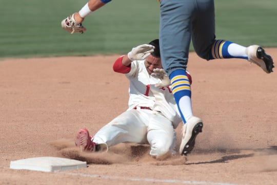 Jordan Sprinkle slides into third base in a Division 1 playoff game against La Mirada, Palm Desert, Calif., May 7, 2019.
