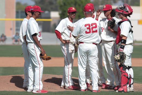 Palm Desert meets for a timeout in a Division 1 playoff game against La Mirada, Palm Desert, Calif., May 7, 2019.