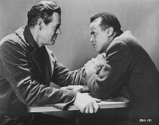 """Robert Ryan (left) and Harry Belafonte star in """"Odds Against Tomorrow."""""""