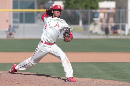 Emiliano Torres pitches for Palm Desert baseball in a Division 1 playoff game against La Mirada, Palm Desert, Calif., May 7, 2019.