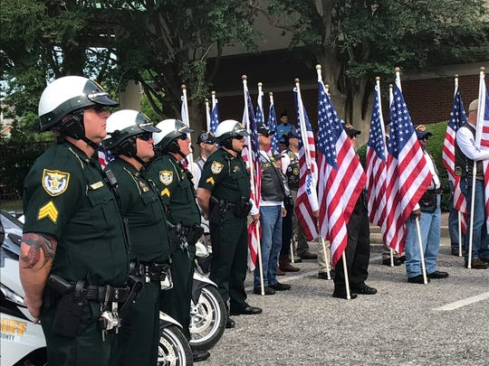 Escambia County Sheriff's Office deputies honor the 14 Pensacola Police Department officers who lost their lives in the line of duty between 1889 and 1997.