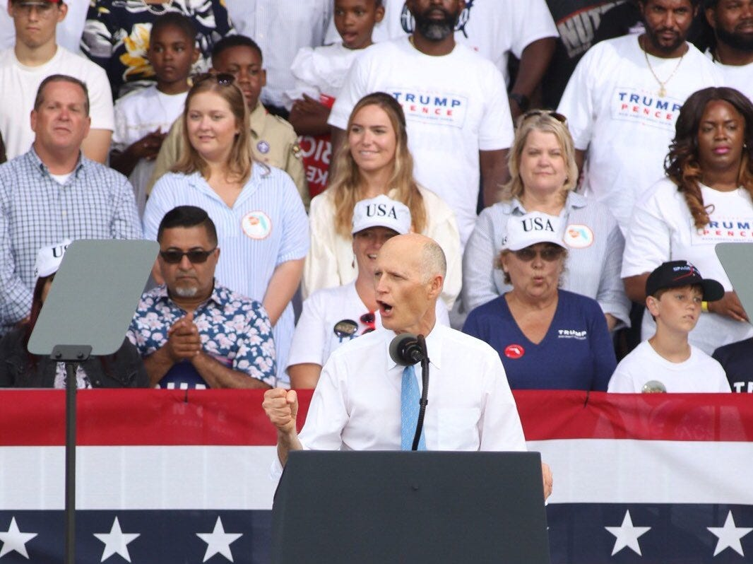 Sen. Rick Scott, R-Fla., speaks to the crowd at the Donald Trump re-election campaign rally at Panama City Beach, Fla., on Wednesday, May 8, 2019.