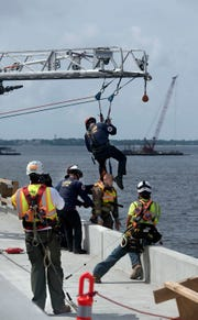 Skanska USA and members of the Pensacola Fire Department, Escambia County Fire Rescue and the Gulf Breeze Volunteer Fire Department conduct a joint training exercise Wednesday at the new Pensacola Bay Bridge as part of National Safety Week.