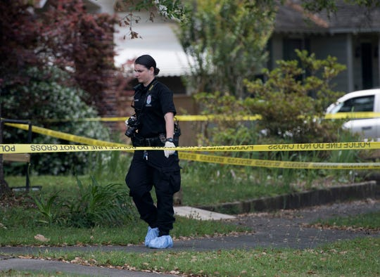 Pensacola police respond Wednesday to a home in the 1000 block of East Lee Street, where a body was found.