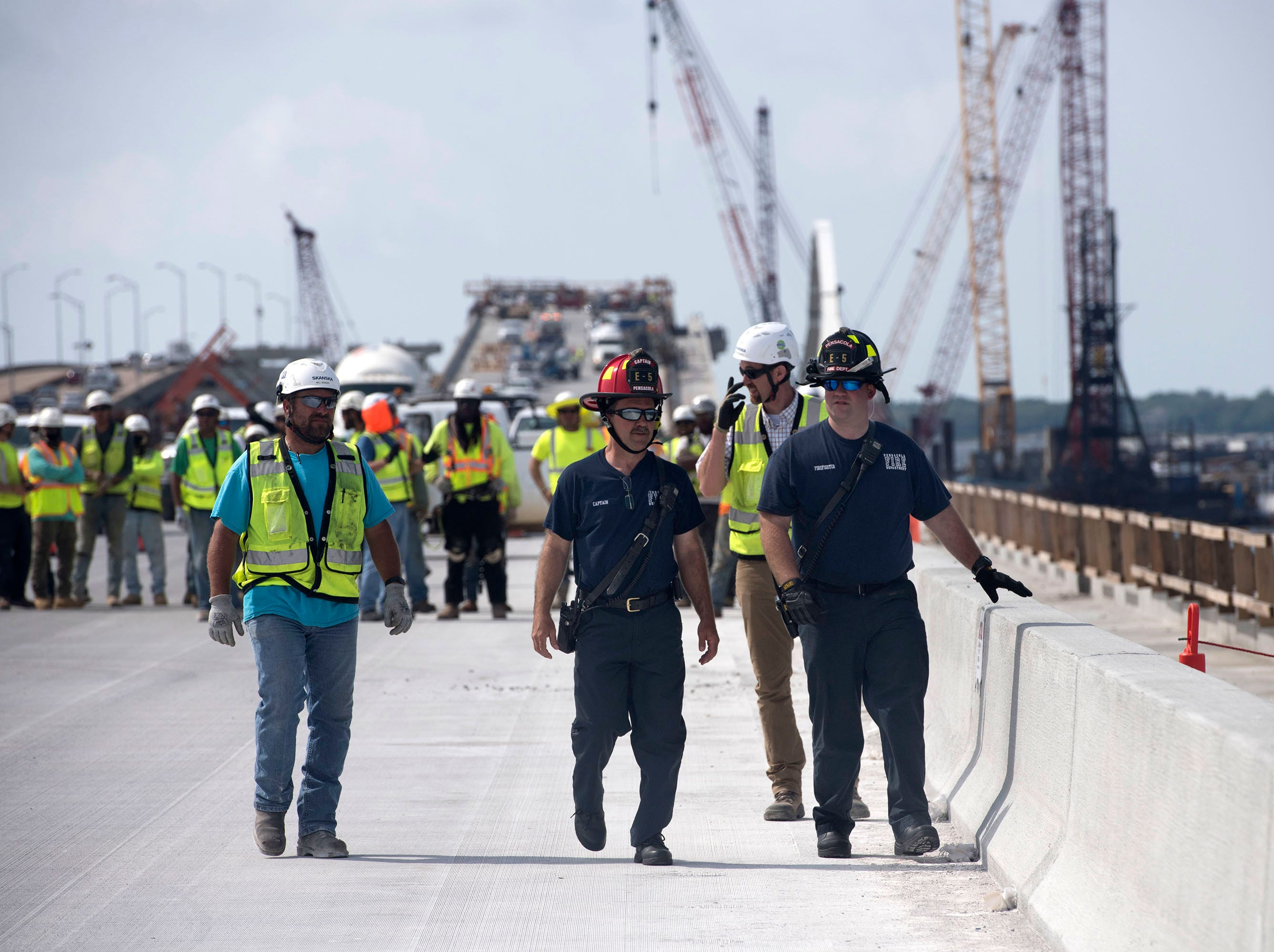 Skanska USA and members of the Pensacola Fire Dept., Escambia Fire Rescue, and the Gulf Breeze Volunteer Fire Dept. join forces to conduct a joint training exercise on the new Pensacola Bay Bridge under construction on Wednesday, May 8, 2019. The training exercise is part of the company's observance of National Safety Week.