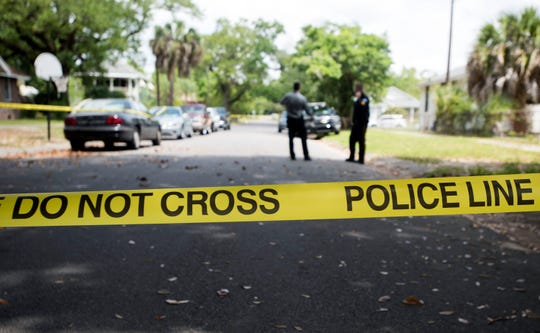 Pensacola police investigate Wednesday after a body was found at a home near 11th Avenue and Lee Street.