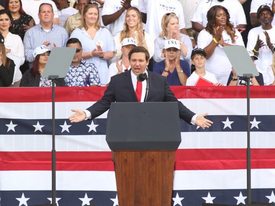 Gov. Ron DeSantis talks to the crowd at the Donald Trump re-election campaign rally at Panama City Beach, Fla., on Wednesday, May 8, 2019.