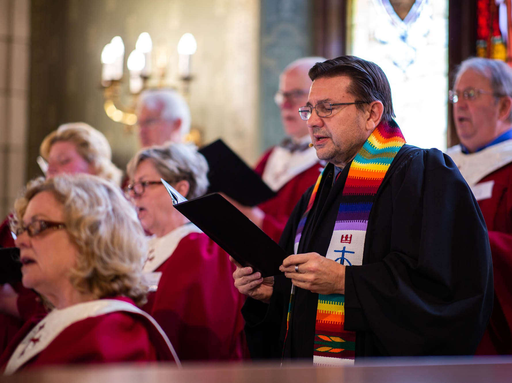 Reverend Russell Clark sings in the choir during a diversity service at the Emmanuel United Church of Christ, Sunday, April 7, 2019, in Hanover. Reverend Clark is the first openly gay pastor at the church.