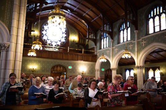 The congregation follows along in their bibles during a diversity service at the Emmanuel United Church of Christ, Sunday, April 7, 2019, in Hanover.