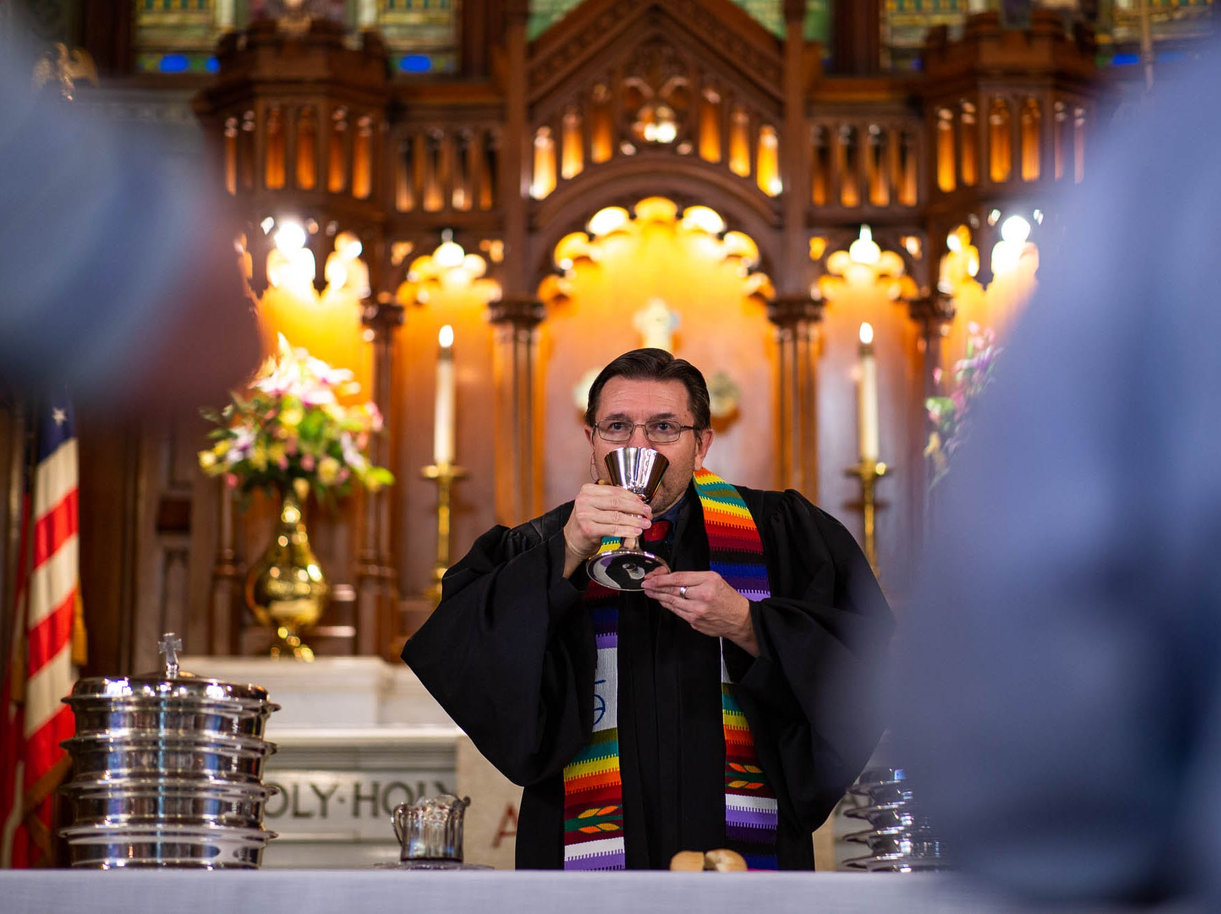 Reverend Russell Clark leads his congregation in communion during a diversity service at the Emmanuel United Church of Christ, Sunday, April 7, 2019, in Hanover. Reverend Clark is the first openly gay pastor at the church.