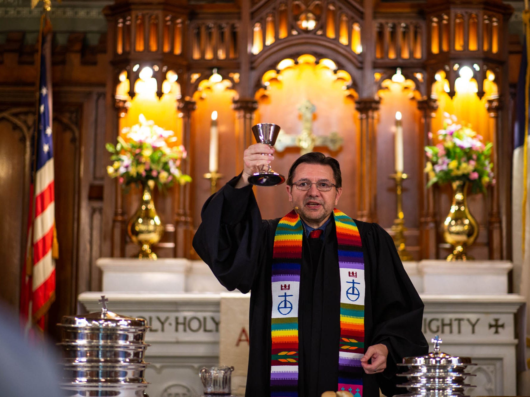 Reverend Russell Clark prepares to lead his congregation in communion during a diversity service at the Emmanuel United Church of Christ, Sunday, April 7, 2019, in Hanover. Reverend Clark is the first openly gay pastor at the church.