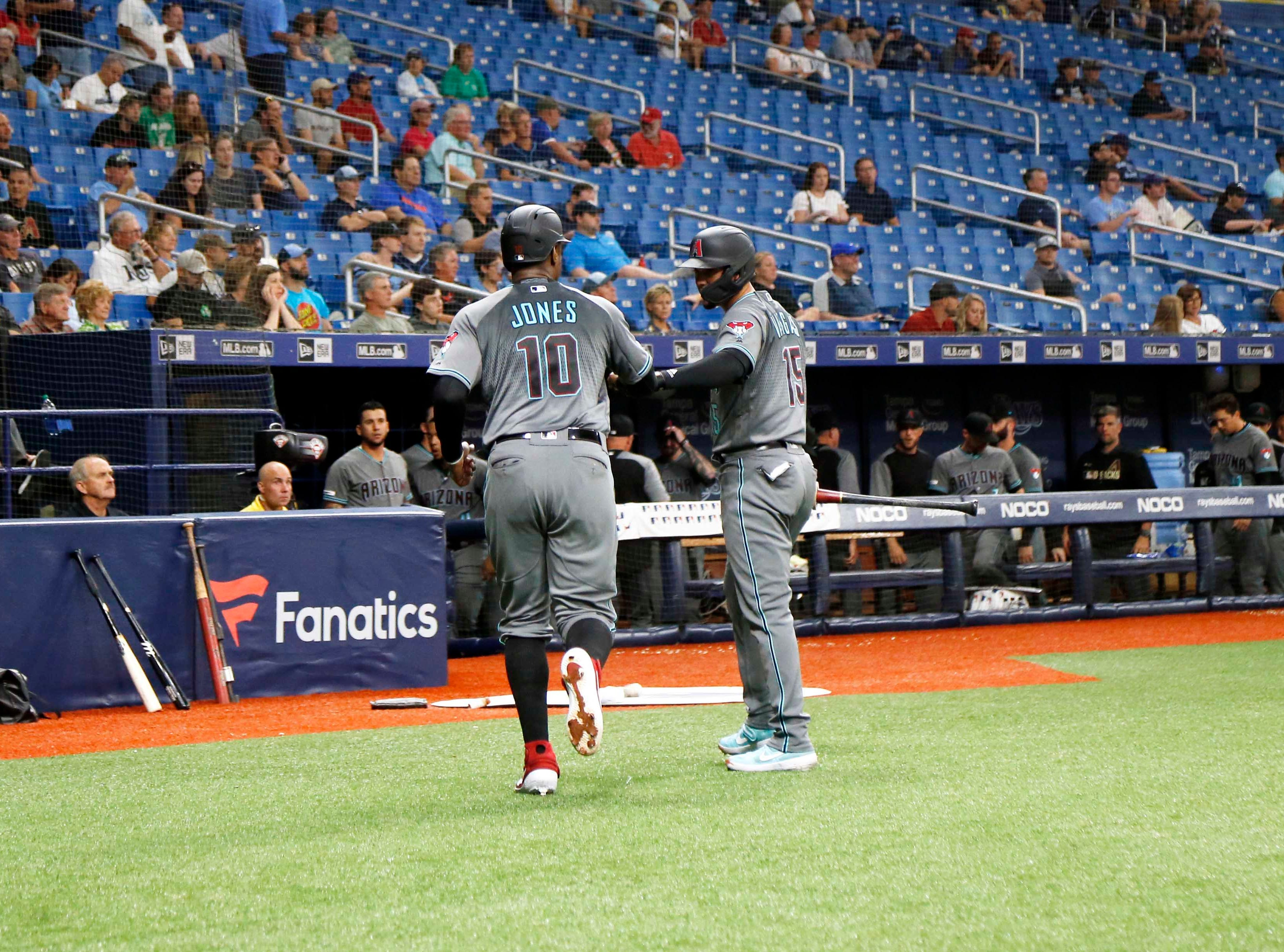 May 7, 2019; St. Petersburg, FL, USA; Arizona Diamondbacks right fielder Adam Jones (10) is congratulated by second baseman Ildemaro Vargas (15) as he scores during the fourth inning against the Tampa Bay Rays at Tropicana Field. Mandatory Credit: Kim Klement-USA TODAY Sports
