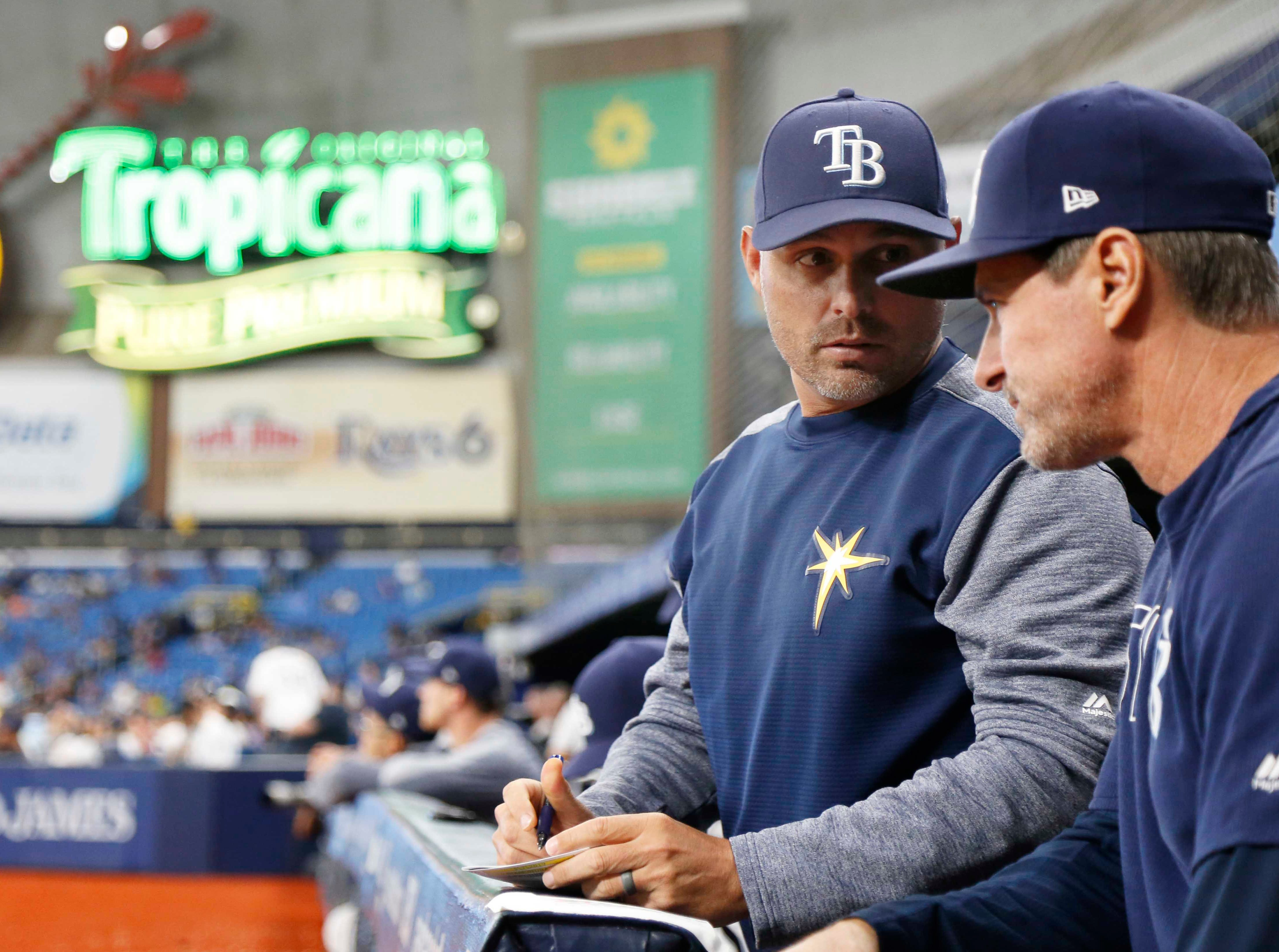May 7, 2019; St. Petersburg, FL, USA; Tampa Bay Rays manager Kevin Cash (16) talks with hitting coach Chad Mottola (51) during the fourth inning against the Arizona Diamondbacks at Tropicana Field. Mandatory Credit: Kim Klement-USA TODAY Sports