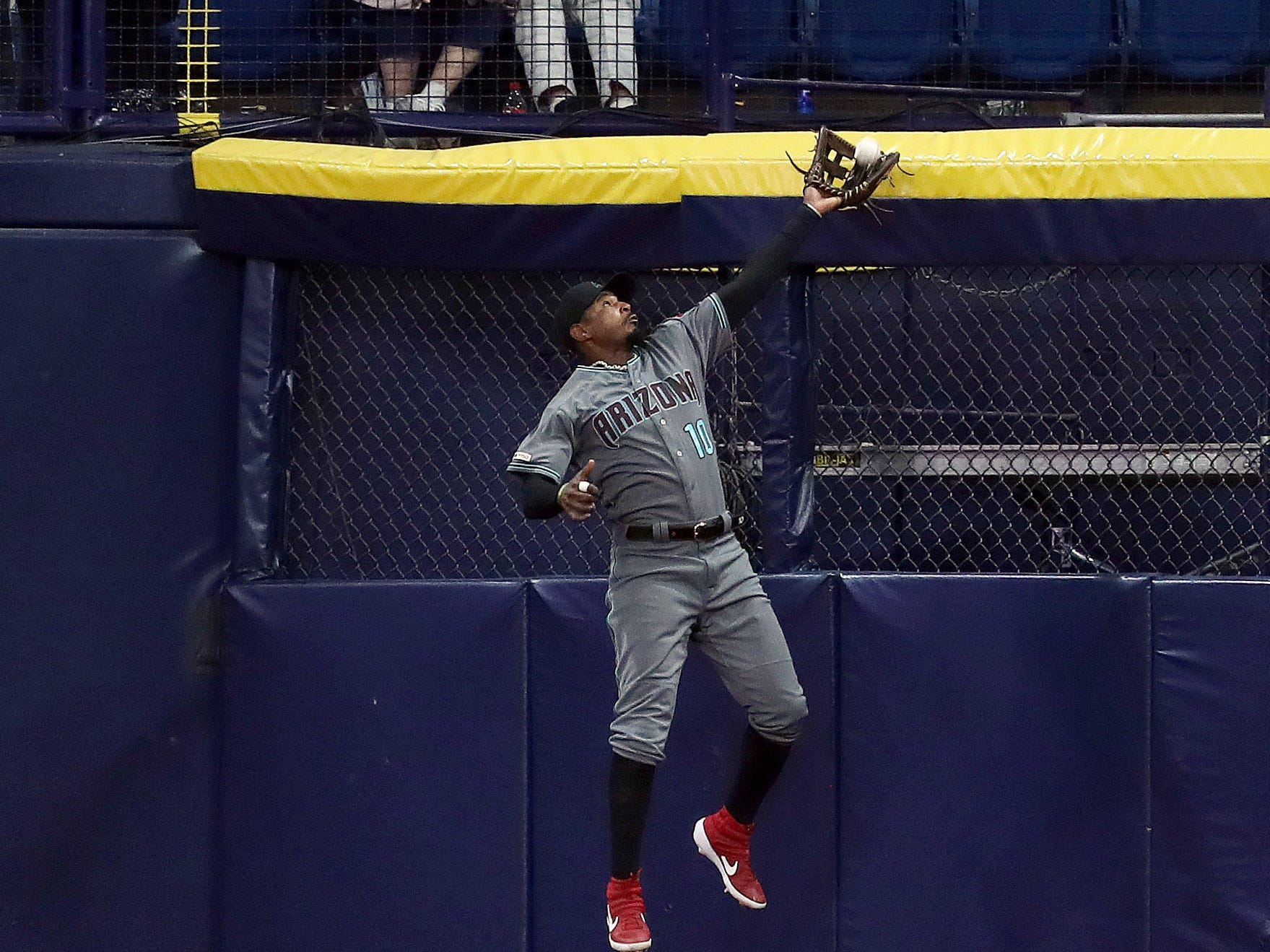 May 7, 2019; St. Petersburg, FL, USA; Arizona Diamondbacks right fielder Adam Jones (10) catches a fly ball during the second inning against the Tampa Bay Rays at Tropicana Field. Mandatory Credit: Kim Klement-USA TODAY Sports