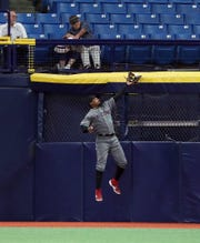 Adam Jones catches a fly ball near the right-field corner against the Rays on Tuesday.